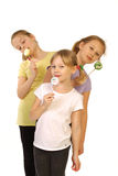 Girls with lollipop on a white background Royalty Free Stock Photo