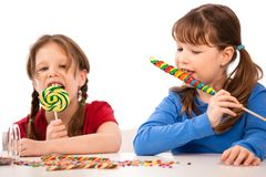 Girls with lollipops Royalty Free Stock Photography