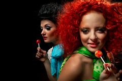 Girls with lollipops Royalty Free Stock Image