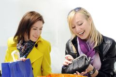 Girls look at their purchases Royalty Free Stock Photography