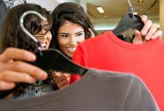 Girls lookig at clothes Royalty Free Stock Photos