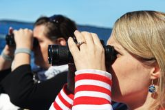 Girls looking through binoculars Royalty Free Stock Photo