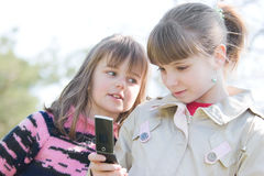 Girls looking at cellphone Royalty Free Stock Photo