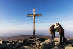 The girls are looking at a map at the top of a mountain at the cross. Bayerischer Wald Nationalpark. Mountain Lusen in the bavaria Stock Photography