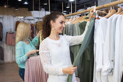 Girls looking for new garments Stock Photo