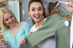 Girls looking for new garments Stock Photos