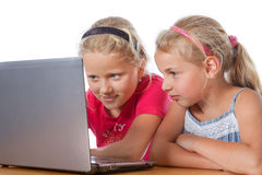 Girls looking on a notebook Stock Images