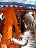 Amsterdam, Girls looking at an orange feather boa  Stock Photos