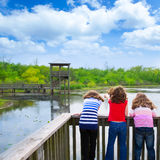 Girls looking at park lake in Texas Royalty Free Stock Photography