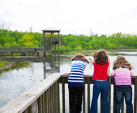 Girls looking at park lake in Texas Royalty Free Stock Photo