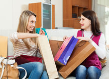 Girls looking shopping bags Stock Photography