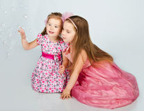 girls looking soap bubbles Royalty Free Stock Images