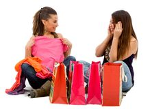 Girls looking at their purchases Royalty Free Stock Images