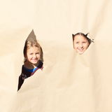 Girls looking thru holes royalty free stock images