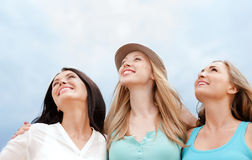 Girls looking up in the sky Royalty Free Stock Image