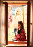Girls looking into window Stock Image