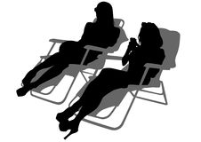 Girls in loungers Royalty Free Stock Images