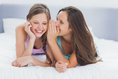 Girls lying in bed Stock Photos