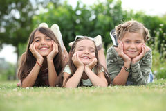 Girls lying on grass Royalty Free Stock Image