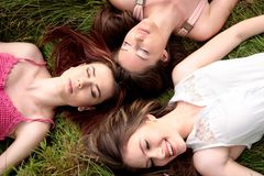 Girls lying on grass Stock Photos