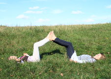 Girls lying in grass Stock Photography