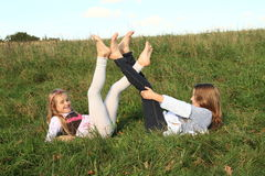 Girls lying in grass Royalty Free Stock Photography