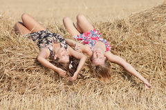 Girls lying on hayloft Stock Photography