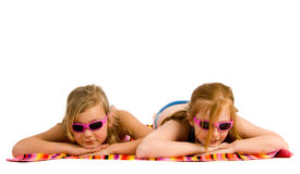 Girls lying in the sun Stock Photos
