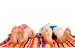 Girls lying in the sun Stock Image