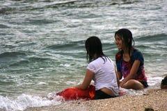 Girls lying on the Sundak beach Royalty Free Stock Photos
