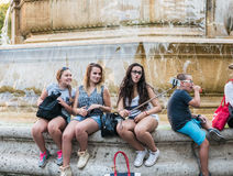 Girls make funny faces for selfie at Place Saint Sulpice, Paris, Stock Photography