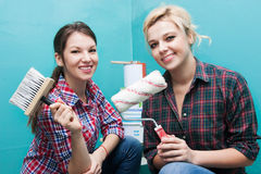 Girls make repairs Stock Photos