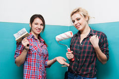 Girls make repairs Stock Photography