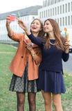 Girls make selfie  with ice cream. Girls make selfie phone with ice cream Royalty Free Stock Image