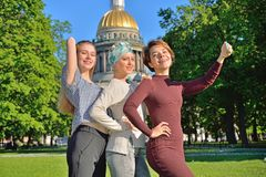 Girls make selfie on a phone on the background of St. Isaac`s Ca Stock Photography