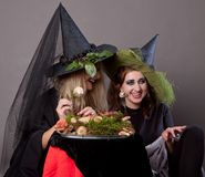 Girls make up as witches. Dining mushrooms Stock Photography