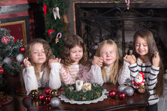 Girls makes a wish at Christmas royalty free stock image
