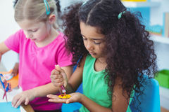 Girls making arts and crafts together Royalty Free Stock Photo