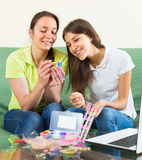 Girls making decorative bracelets Stock Photography