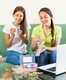 Girls making decorative bracelets Stock Image