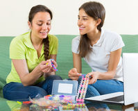 Girls making decorative bracelets Royalty Free Stock Image