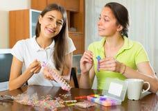 Girls making decorative bracelets Royalty Free Stock Photography