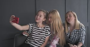 Girls making faces while taking selfie stock video