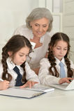 Girls making homework with granny Royalty Free Stock Photo