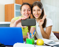 Girls making photo on mobile phone Royalty Free Stock Images