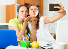 Girls making photo on mobile phone Royalty Free Stock Photography