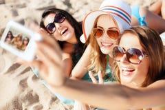 Girls making self portrait on the beach stock photos