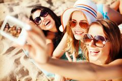 Girls making self portrait on the beach Stock Photos