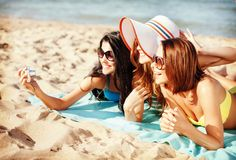 Girls making self portrait on the beach Stock Images