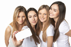 Girls making self portrait with a smartphone Royalty Free Stock Images